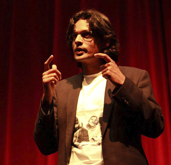 Photo of Shamnad on stage addressing a crowd