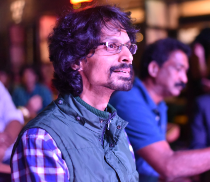Photo of Shamnad looking at the stage during the IFL (IDIA Football League) Night, 2018